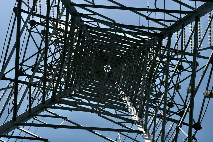 Low angle view of grid structure against sky