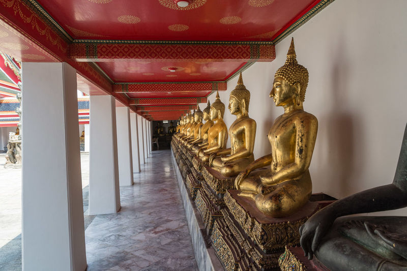 Bangkok Buddha Architectural Column Architecture Art And Craft Belief Buddha Statue Buddhism Buddhist Temple Building Built Structure Ceiling Creativity Human Representation Idol In A Row Male Likeness No People Place Of Worship Religion Representation Sculpture Spirituality Statue Travel Destinations