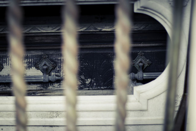 La Recoleta Cemetery, Buenos Aires, Argentina Upper class death in Argentina. The myriad of tombs and mausaleums open to the public housing the wealthy and famous of Argentine society. A macabre place of death and celebration. The Photojournalist - 2018 EyeEm Awards Architecture Built Structure Close-up Day Focus On Background Grate Grid Metal Nature No People Outdoors Protection Rail Transportation Railing Security Selective Focus Transportation Window Wood - Material