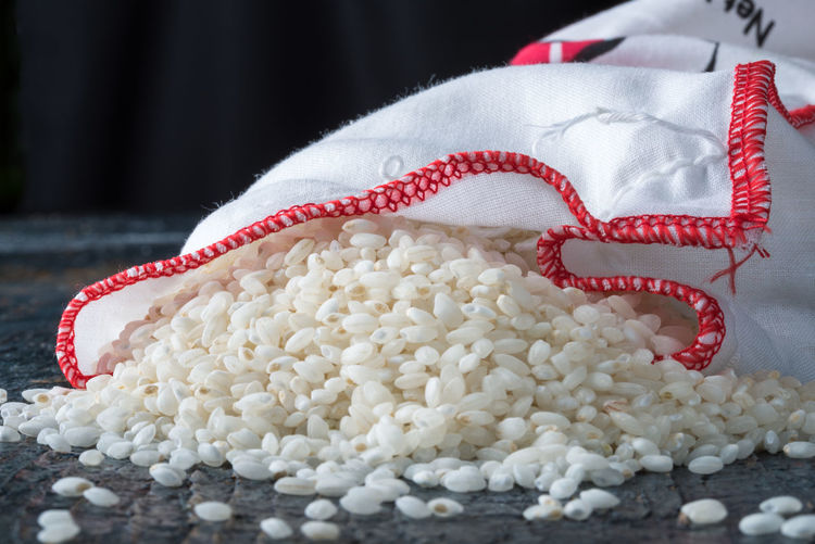 Close-Up View Of White Fabric And Rice