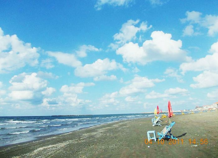 Sea Beach Sand Cloud - Sky Travel Destinations Outdoors Vacations No People Sky Scenics Water Beauty In Nature Day Nature Wheelchair Access Raselbar Nature Horizon Over Water Sea And Sky Seascape Umberellas Beauty In Nature