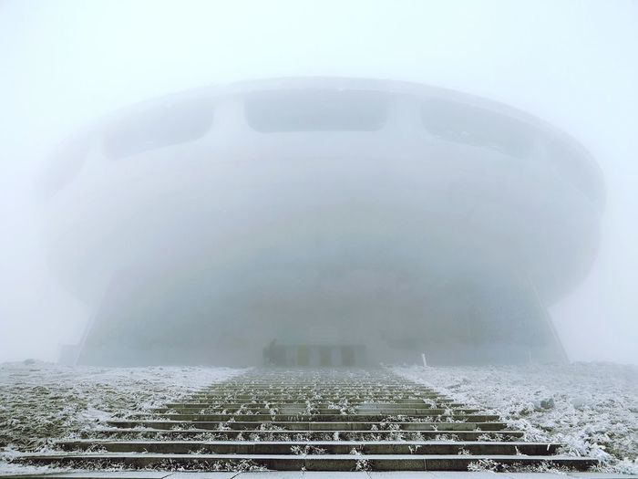 Out of this world Winter Bulgaria Bulgaria❤️ Travel Destinations Iconic Buildings Iconic Landmark Buzludzha Buzludja Architecture Architecture_collection Architecture And Art EyeEm Best Shots Eyeemarchitecture Nopeople Cold Weather Mobile Photography Copy Space Huaweip20pro Stockphoto Stockimage Eastern Europe Sofia, Bulgaria Huaweiphotography Frozen Backgrounds Sky Landscape Foggy Storm Cloud Extreme Weather