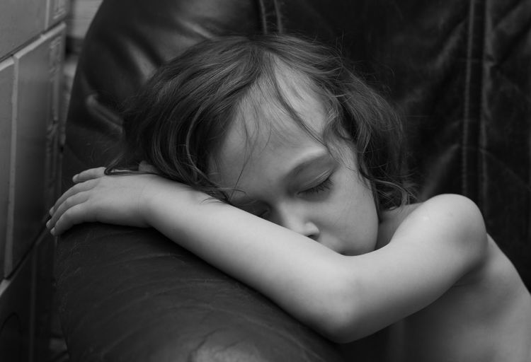 Portrait of cute kid relaxing on sofa