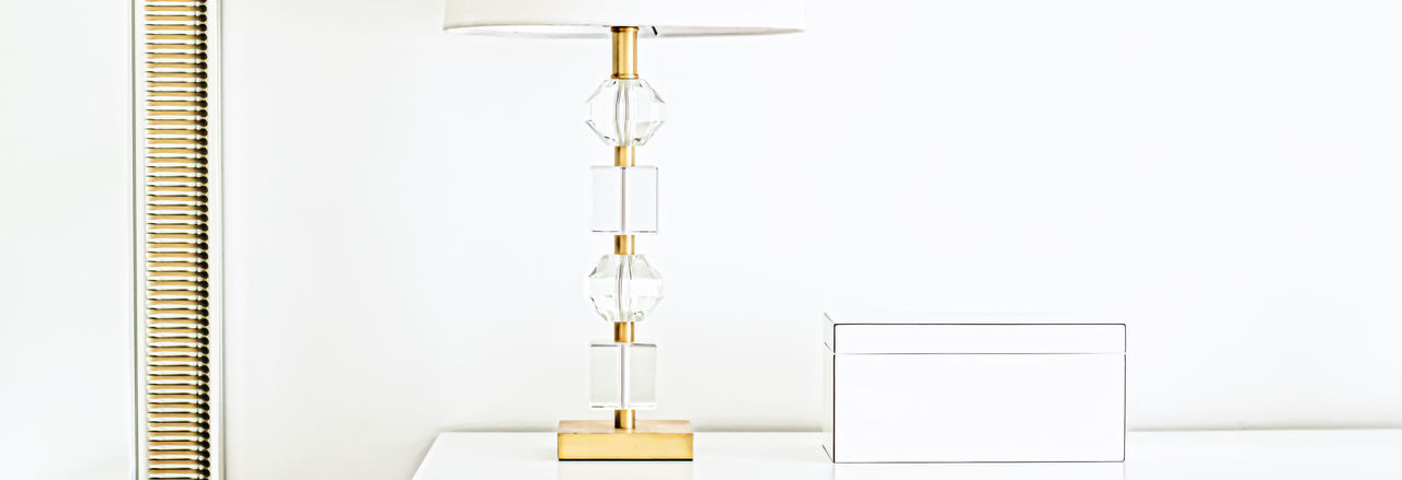 Close-up of lamp on table against white background