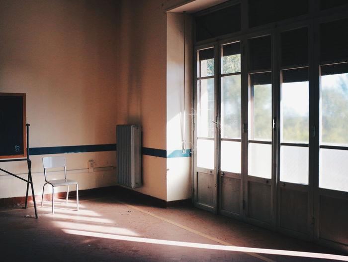 Sunlight Falling Through Door On Floor In Room