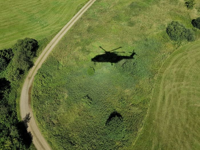 High angle view of helicopter shadow on landscape