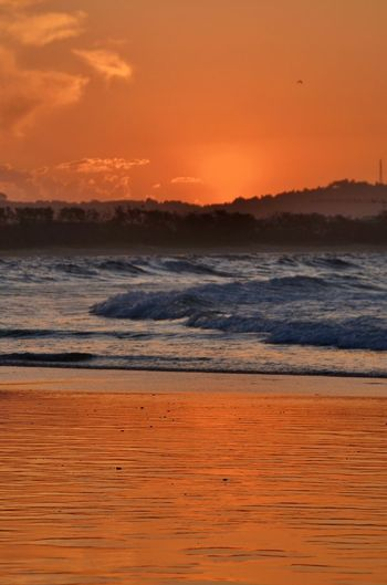 Beach Beauty In Nature Golden Hour Mirror-like Surface Reflection Sea Seascape Shore Sky Sunset Tranquil Scene Wave Wet Sand Wet Sand Reflection
