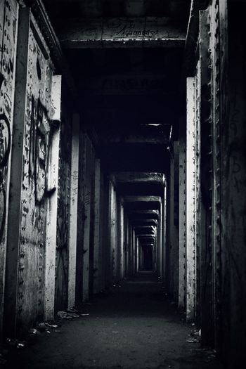 tunnel vision 2......... Tunnel Urban Gritty One Point Perspective Tunnel Vision Walkway Black And White Black And White Photography Noir Claustrophobic Architecture Built Structure Abandoned Corridor Run-down Diminishing Perspective Deterioration Decline Empty Absence