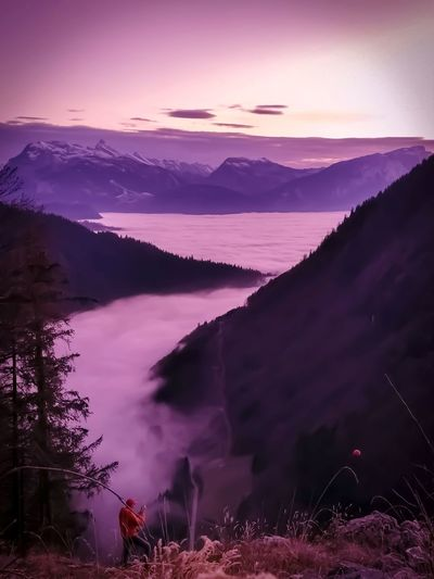 Purple sunset mountains with valley clouds