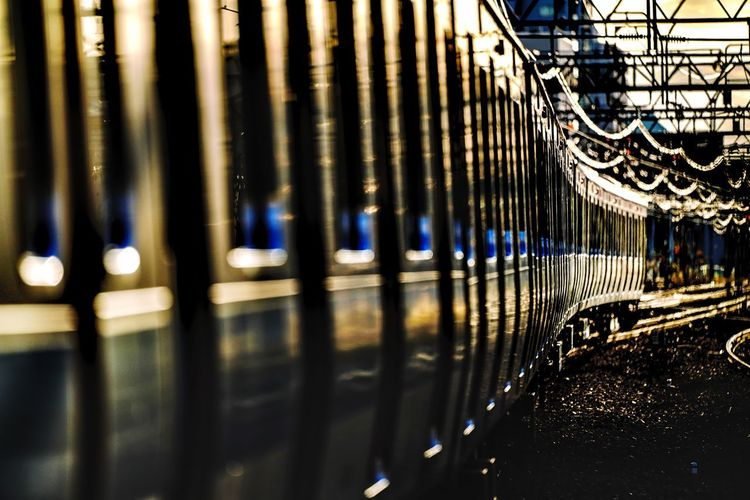 City Life Evening Light Sunlight Reflection Reflections Train No People Building Exterior Illuminated Water Pattern Reflection Outdoors Metal Transportation Transportation Reflection Selective Focus Focus On Foreground City