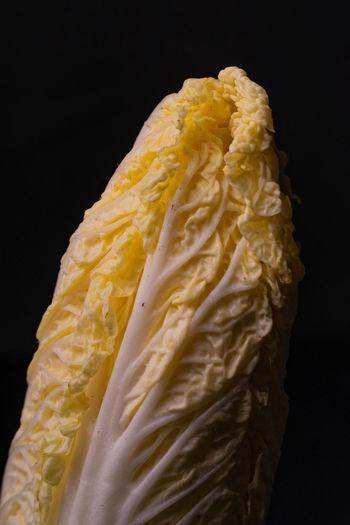 Close-up of ice cream against black background