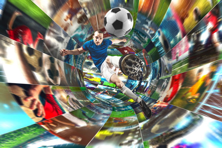 Low angle view of people playing soccer ball