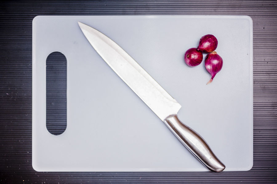 Chopping Board Commercial Cooking Cutting Boards Cuttlery Food Foodphotography Ingredients Kitchen Knife Objects Onion Stainless Steel Knife Still Life Photography Subject Vegetable