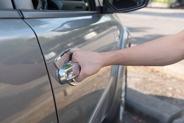 Cropped Hand Opening Car Door