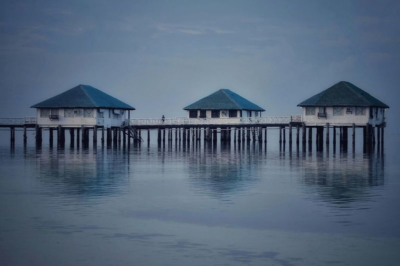 Stilts Resort: Calatagan, Batangas Philippines EyEmNewHere Reflections In The Water Reflection Reflections Beachphotography Beach Photography Beach Beach View Beachscape Water Sea Stilt House Thatched Roof House Sky Architecture Building Exterior Built Structure Stilt Beach Hut