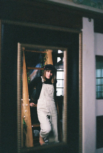 Mirror Reflection Doorway Full Length Indoors  Looking At Camera One Person One Woman Only Overalls Portrait Standing