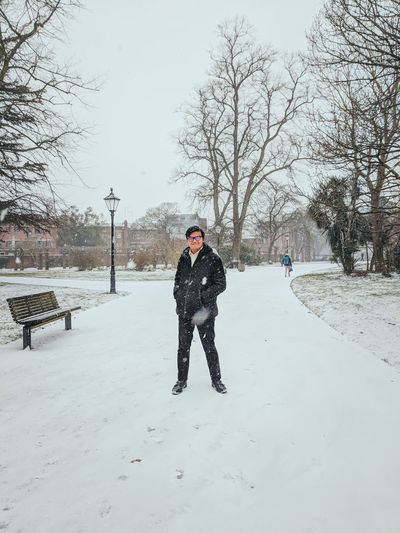 Man walking on the street and park during winter.Snow covered the pathway. LONDON❤ London Snow ❄ Trip Winter Wintertime Cold Temperature Europe Horizon Over Water Park Real People Snow Snow Covered Snowflake Street Walking Warm Clothing Winter