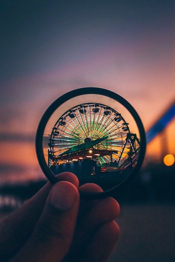 Human Hand Human Body Part Holding Real People Illuminated Human Finger One Person Focus On Foreground Night Outdoors Close-up Lifestyles Ferris Wheel Sky People EyeEmNewHere EyeEm Ready