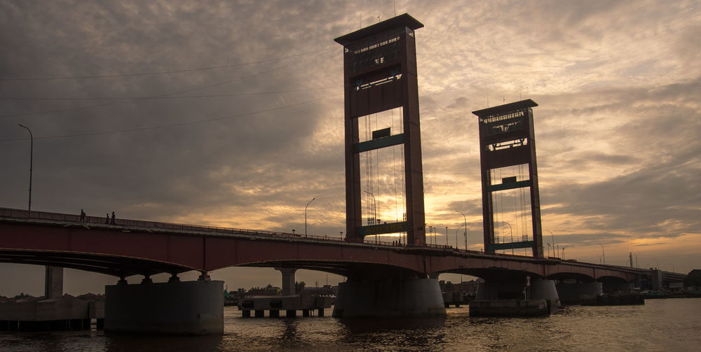 ampera bridge Bridge Palembang INDONESIA Ampera Business Finance And Industry Sunset Business Cloud - Sky Travel Destinations Built Structure Steel