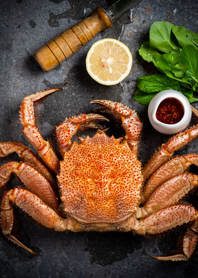 High angle view of crab by lemon on table