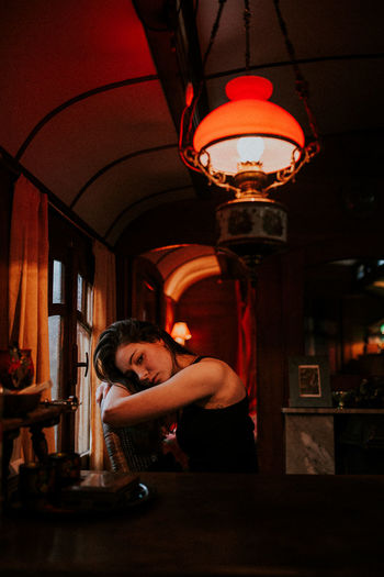 Artificial Light Atmospheric Mood Beautiful Woman Chair Circus Circus Waggon Illuminated Indoors  Inside Inside Out Lamp Lonely Melancholy Portrait Rainy Days Red Red Light Relaxing Sad Sadness Sitting Skin Thinking Warmth Without You