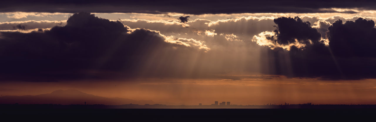 Dramatic sunrise over the Los Angeles skyline with light rays Sky Cloud - Sky Sunset Beauty In Nature Scenics - Nature Tranquil Scene Silhouette Environment Nature Tranquility Sunbeam Dramatic Sky Sunlight Landscape Cloudscape No People Outdoors Horizon Over Land Mountain Sun Dark
