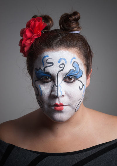 Close-up of woman with face paint at home during halloween