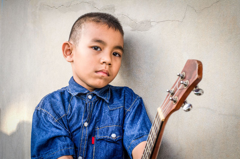Asian boys and Ukulele Asian  Country Jeans Practice Skill  Smart Boys Child Childhood Chord Education Guitar Hobbies Hobby Innocence Jean Leisure Activity Music Musical Equipment Musician Playing Popular Portrait Song Ukulele