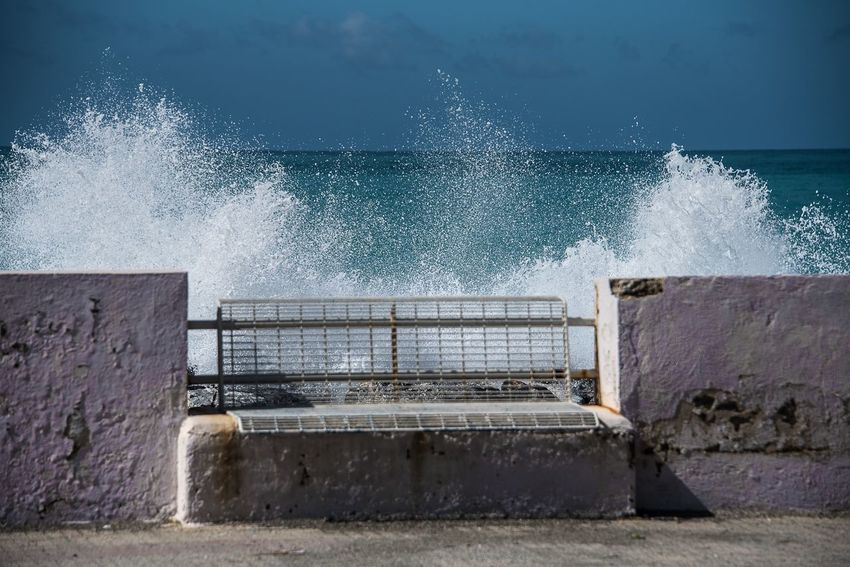 Bench and Waves Water No People Outdoors Day Built Structure Motion Architecture Sky Nature Spraying