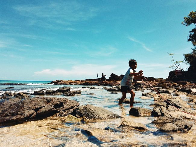Child Boy Childhood Playing Fishing Exploring Growing Up Learning Action Shot  Seaside Sea And Sky Rocks And Water Running Travel Photography Explore Sabang Itsmorefuninthephilippines Feel The Journey