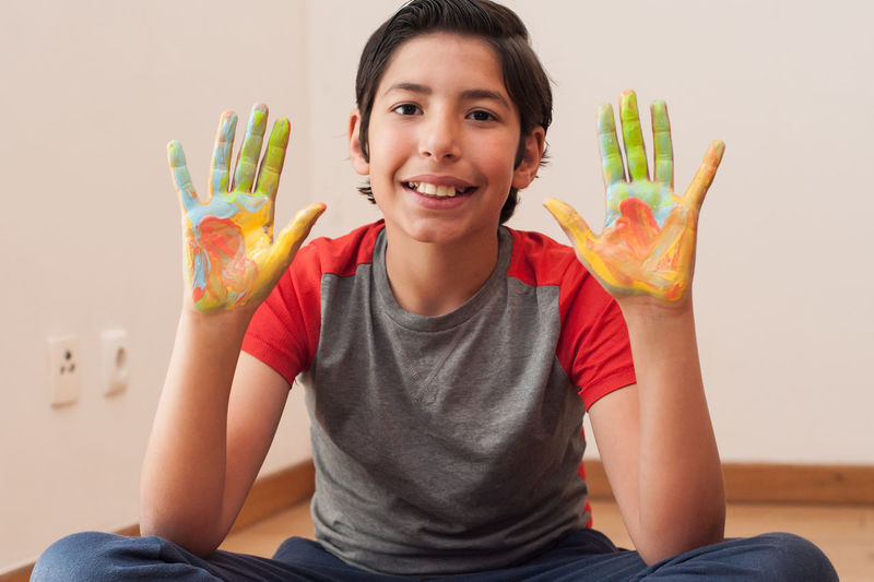 Portrait of boy with messy hands