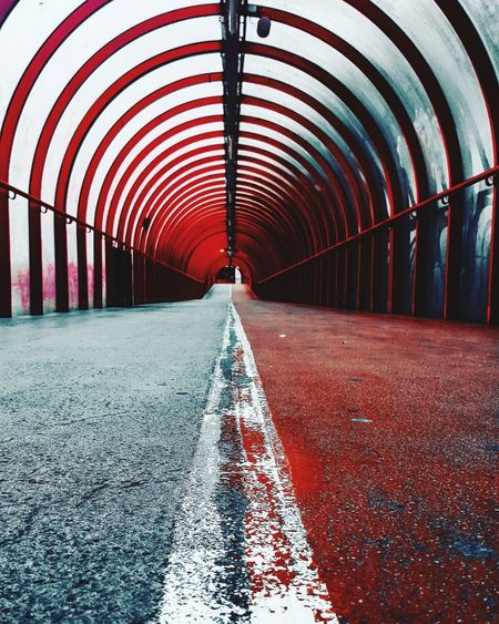 Walking the line Arch Red Architecture Built Structure Covered Bridge Arched vanishing point The Way Forward Pathway Passageway Diminishing Perspective Footbridge Bridge - Man Made Structure Empty Road Pillar Passage