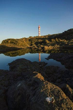 Faro de Sardina Sundown Sunset Landscape Lighthouse Faro Coast Costa Gáldar Gran Canaria Gran Canary Island Norte Mar Reflejos Reflection Conchas Water Water Reflections Canary Islands Photography EyeEm Selects Water Lighthouse Clear Sky Sky Coastline Tranquil Scene