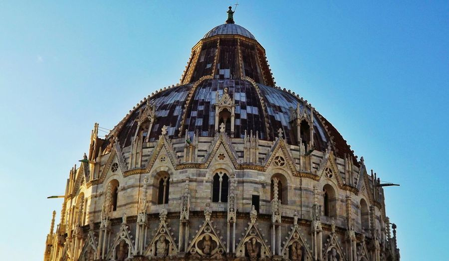 Low angle view of pisa baptistery against clear sky