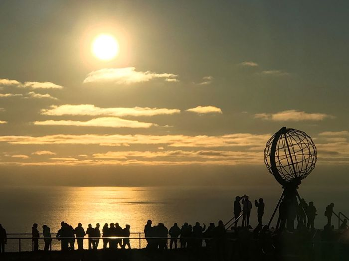 Nordkap Sky Sunset Water Sun Cloud - Sky Silhouette Nature Orange Color Beauty In Nature Group Of People Real People Sea Horizon Over Water Crowd Sunlight Horizon Scenics - Nature Outdoors Reflection Large Group Of People