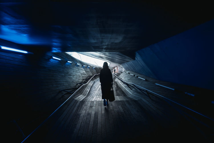 Architecture Architecture_collection The Architect - 2018 EyeEm Awards Architectural Detail Architecture Architecturelovers Direction Illuminated Light At The End Of The Tunnel One Person Public Transportation Rear View The Way Forward Underground Walkway Walking