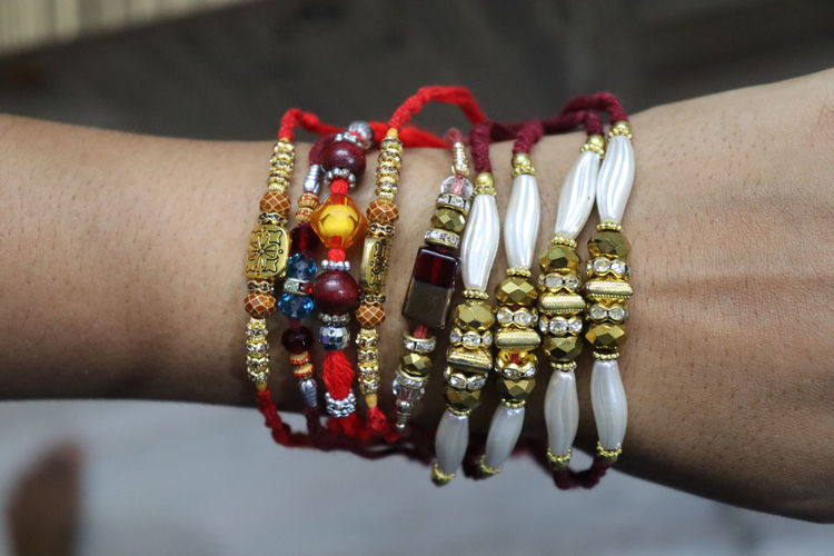 Cropped hand of person with rakhi