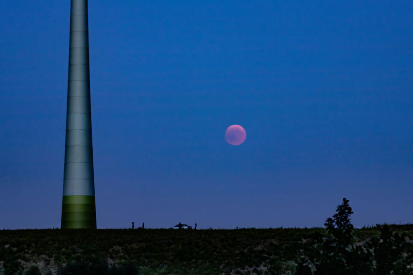 #mooneclipse People Together Pinwheel Ruhrgebiet Astronomy Beauty In Nature Blue Clear Sky Field Full Moon Germany Land Low Angle View Moon Moon Eclipse 2018 Nature Outdoors People Scenics - Nature Sky Tranquil Scene Tranquility Windrad HUAWEI Photo Award: After Dark