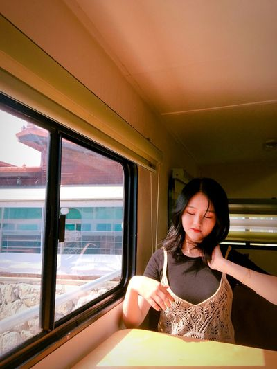 Young woman sitting in bus