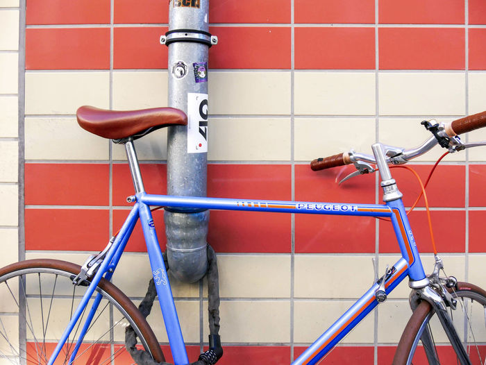 #urbanana: The Urban Playground Architecture Available Light Bicycle Built Structure Close-up Day Flooring Handle Handlebar Land Vehicle Metal Mode Of Transportation No People Outdoors Pipe - Tube Red Stationary Streetphotography Tile Transportation Wall - Building Feature Wheel