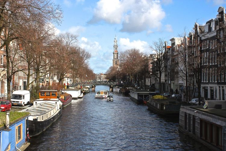 What a view... Architecture Boat Building Built Structure Canal City City Life Day Mode Of Transport Outdoors River Sky The Way Forward Tourism Travel Tree Water Waterfront Your Amsterdam