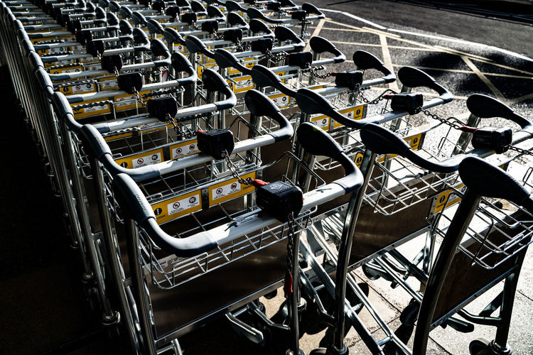 High angle view of empty luggage carts
