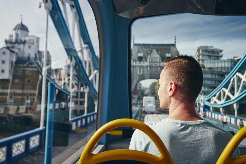 Rear view portrait of man in city