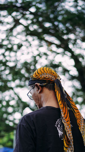 Portrait of a woman against blurred trees