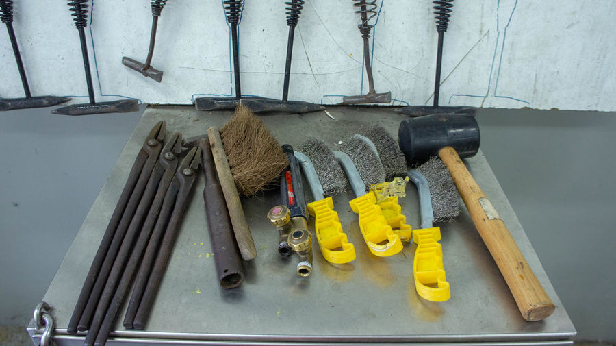 High angle view of tools in container