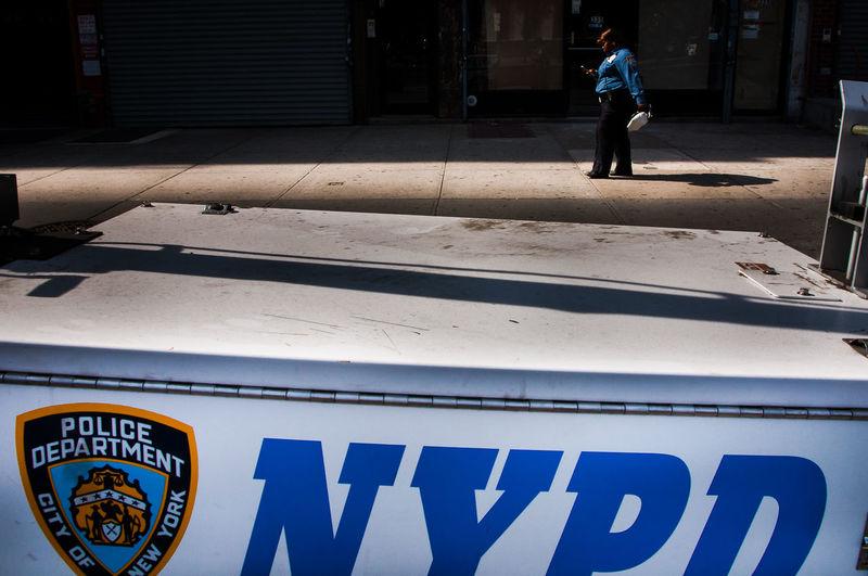 Contrast Harlem  New York New York City NYPD Outdoors Police Policewoman Shade Street Streetphotography The Street Photographer - 2016 EyeEm Awards The Street Photographer - 20I6 EyeEm Awards The Street Photographer -2016 EyeEm Awards USA