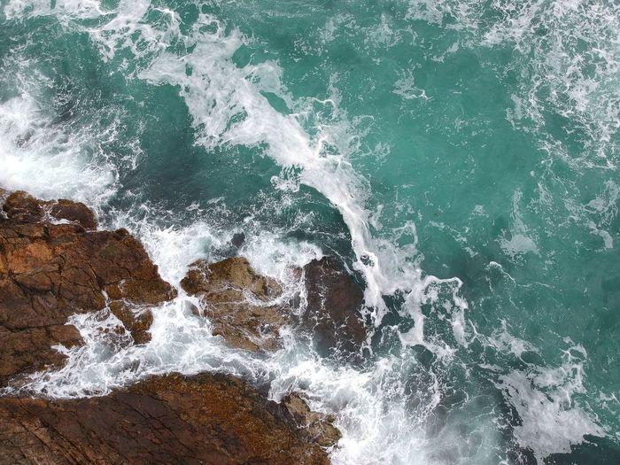 Waves splashing on rocks at shore