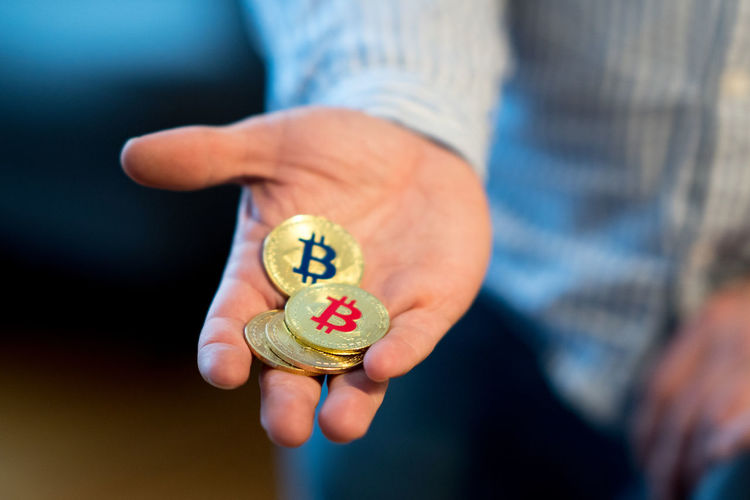 Close-Up Of Person Holding Bitcoins