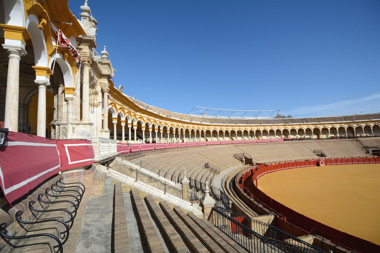 The Bullring of the Real Maestranza of Cavalry of Seville is one of the most beautiful arenas of Spain for the biggest bullfighters of bullfights. Cavalry Of Seville Plaza De Toros Real Maestranza Seville Toréadores Arch Architectural Column Architecture Building Built Structure Bullfight Bullfighter Bullring Bullring, Clear Sky Day No People Ornate Seville,spain Sky Stadium Sunlight Tourism Travel Travel Destinations