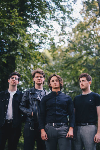 The Carolines- A Cardiff based band Adolescence  Casual Clothing Clothing Day Friendship Front View Group Of People Lifestyles Men Outdoors People Plant Standing Teenage Boys Teenager Three Quarter Length Togetherness Tree Young Adult Young Men Young Women